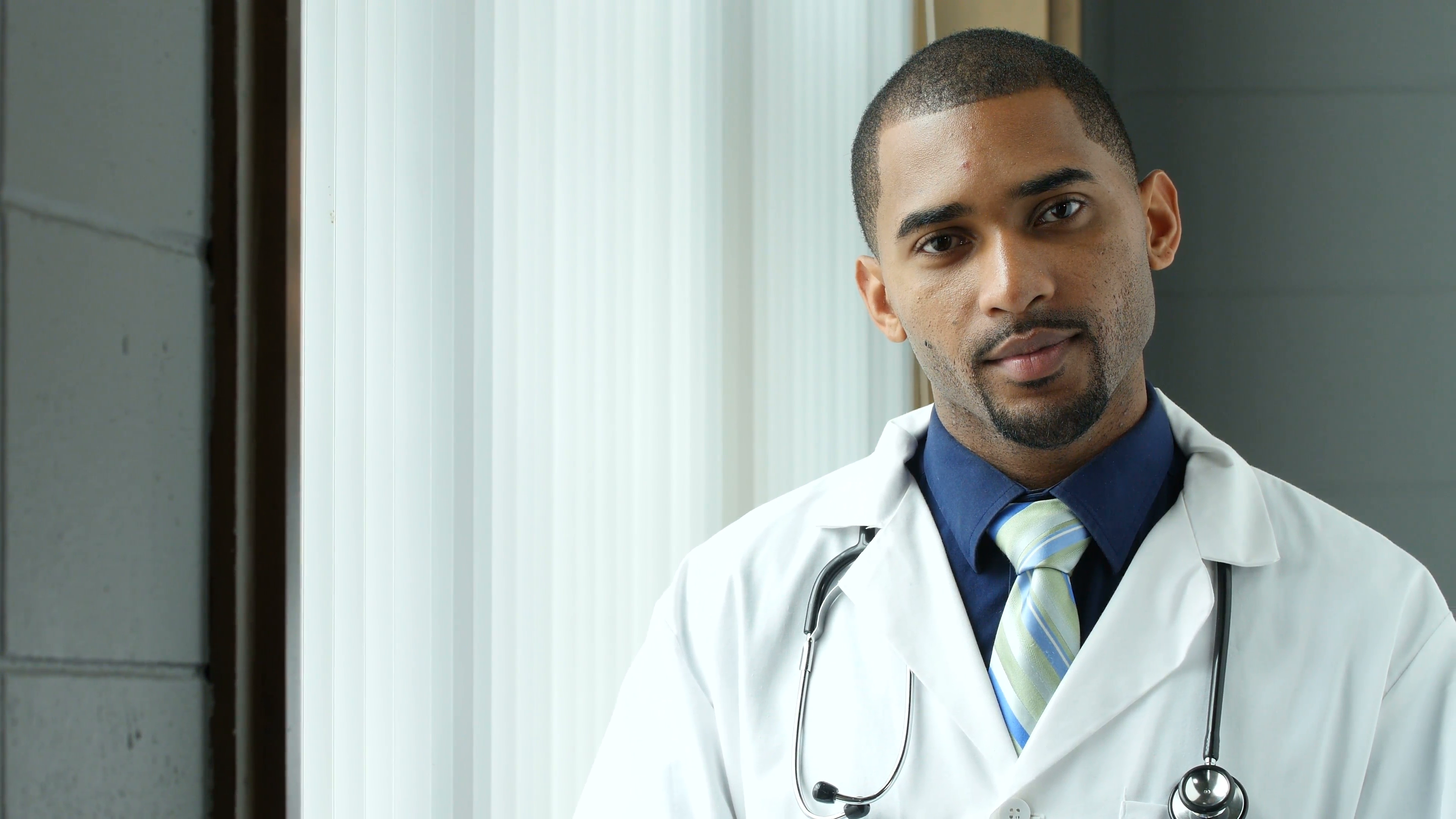 Portrait of a young black male doctor smiling 4yfnr igx  f0004 png