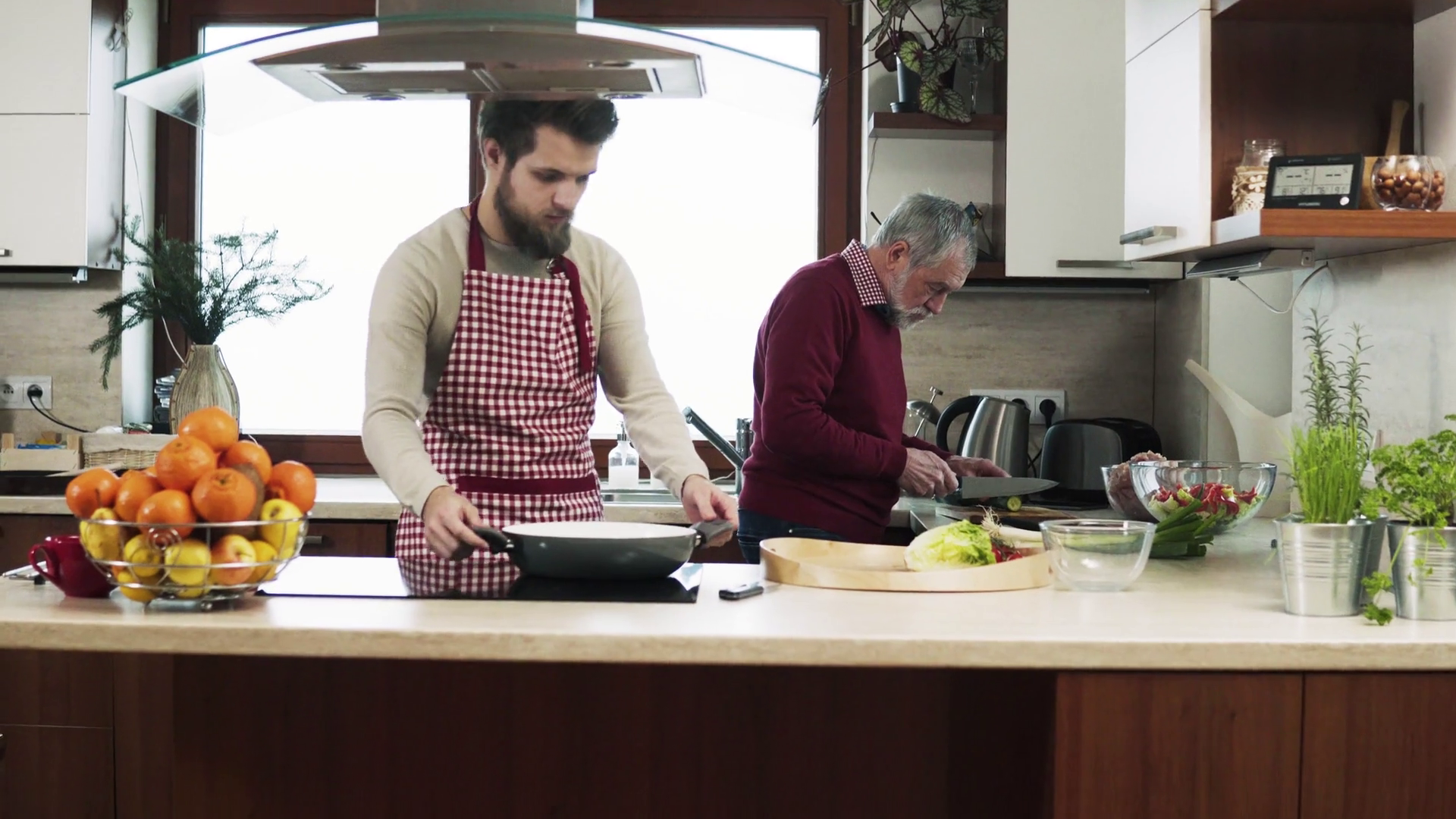 Videoblocks hipster son with his senior father cooking in the kitchen hda1pc7qf thumbnail full01 png